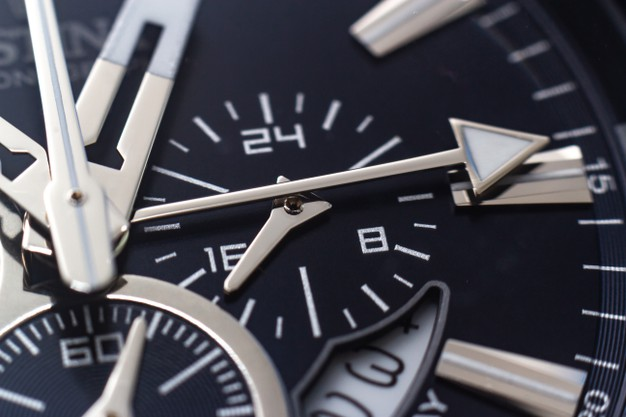 closeup-shot-hands-numbers-hour-marks-black-watch_181624-26818